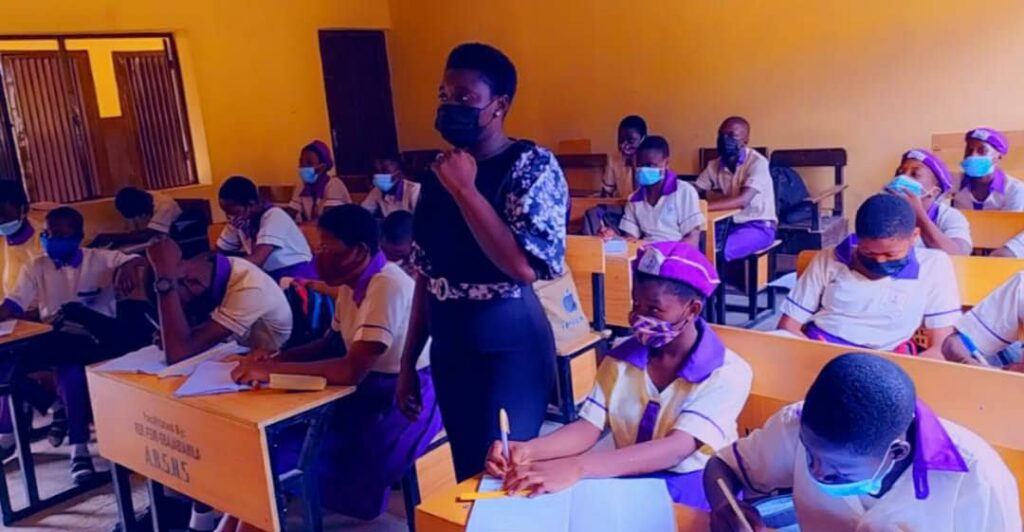 Iretayo Omojowo in class with her students
